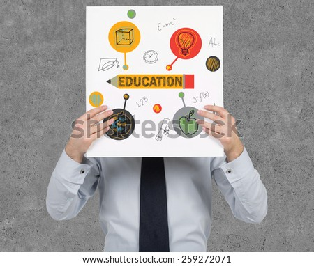 businessman holding poster with education concept - stock photo