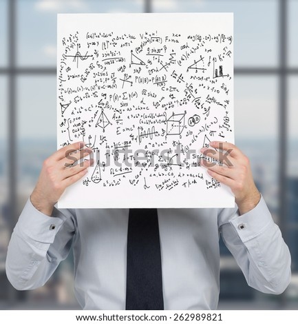 businessman holding poster with mathematics equations and formulas - stock photo
