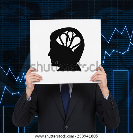 businessman holding poster with silhouette of  head - stock photo