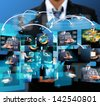 businessman holding Reaching images streaming in hands .Financial and technologies concepts - stock photo