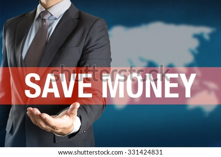 Businessman holding SAVE MONEY word with world background - stock photo