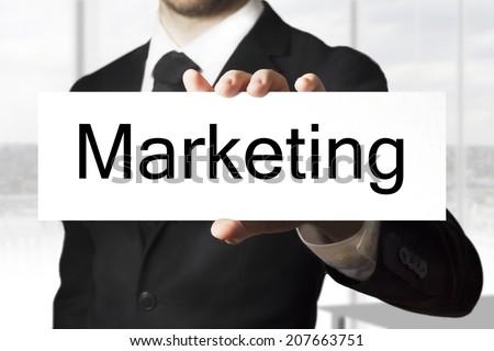 businessman holding sign marketing - stock photo