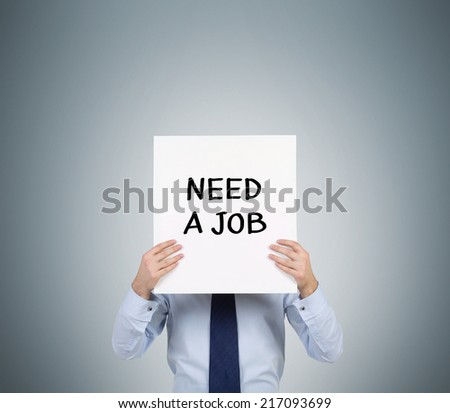 "Businessman holding sign ""need job"" - stock photo"