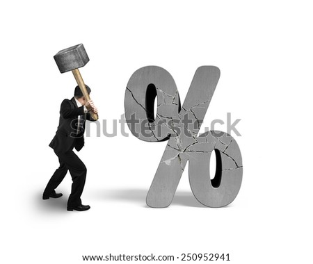 Businessman holding sledgehammer hitting cracked percentage sign isolated on white background - stock photo