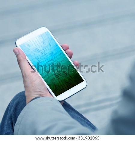 Businessman holding smart phone - stock photo