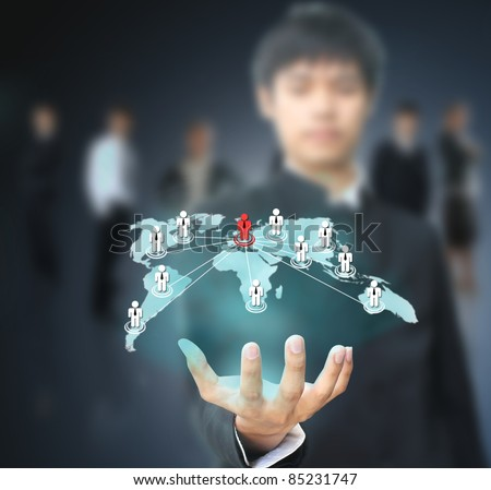 Businessman holding social map - stock photo