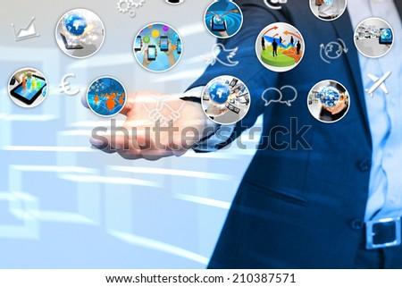 Businessman holding social media. - stock photo