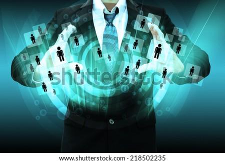 Businessman holding social network - stock photo