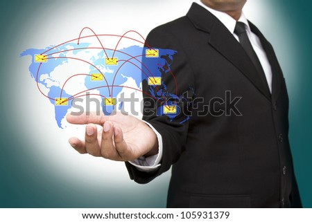 Businessman holding social network and sms - stock photo