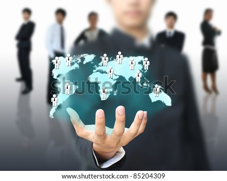 Businessman holding social network map - stock photo
