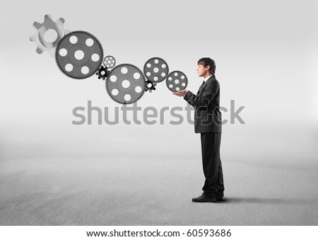 Businessman holding some mechanisms in his hands - stock photo