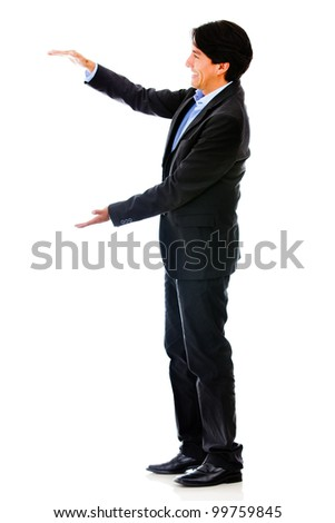 Businessman holding something in his hands - isolated over a white background - stock photo