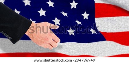 Businessman holding something with his hands against black wall