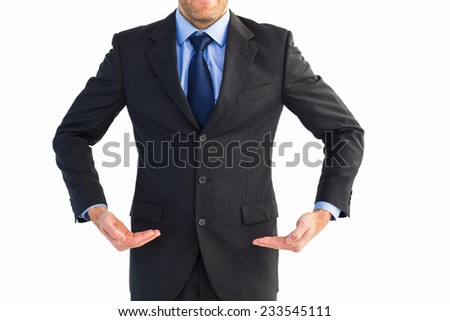 Businessman holding something with his hands on white background