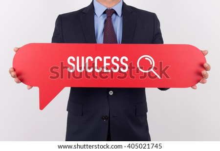 Businessman holding speech bubble with a word SUCCESS - stock photo