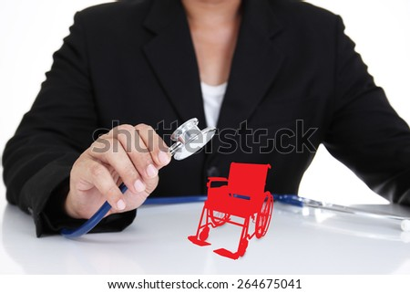Businessman holding stethoscope with wheelchair , insurance concept - stock photo