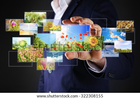 Businessman holding streaming images - stock photo
