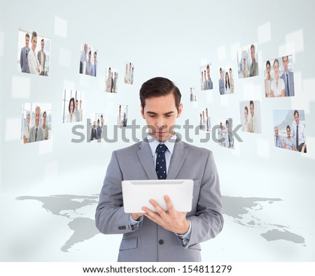 Businessman holding tablet encircled by digital interface of coworkers - stock photo