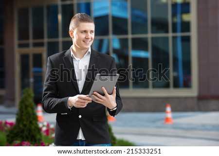 Businessman holding tablet in hand