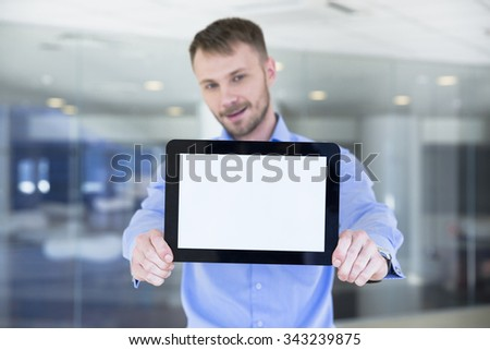 businessman holding tablet in hands - stock photo