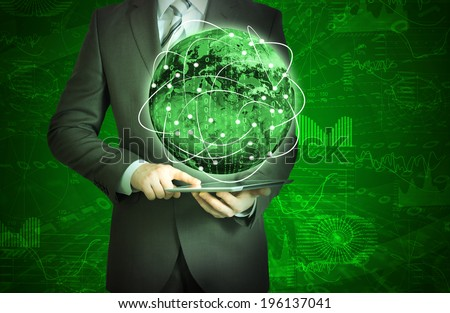 Businessman holding tablet in his hands. Glowing graphs and Earth. Elements of this image are furnished by NASA - stock photo