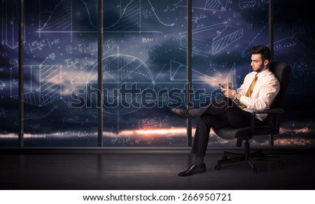 Businessman holding tablet in office room with graph charts on window concept - stock photo
