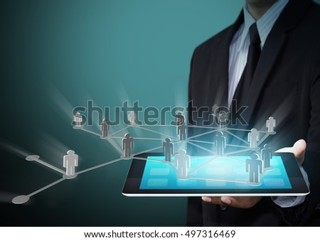 businessman holding tablet with connection and networking concept