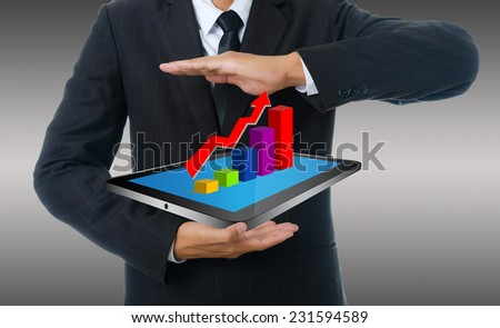 Businessman holding tablet with finance graph for trade stock market, isolated on the white background. - stock photo