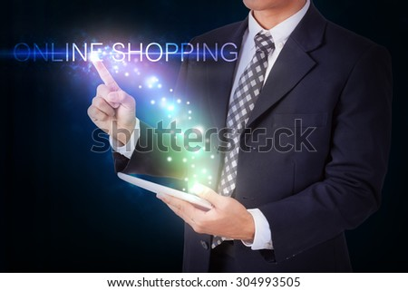 Businessman holding tablet with pressing online shopping.internet and networking concept - stock photo