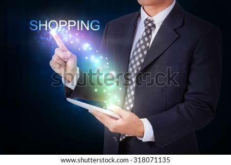 Businessman holding tablet with pressing shopping. internet and networking concept - stock photo