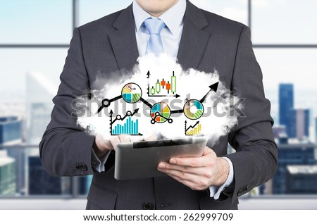 businessman holding tablet with stock chart - stock photo