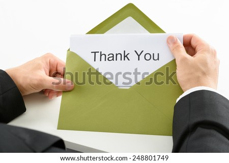 Businessman Holding Thank You Card In Green Envelope - stock photo