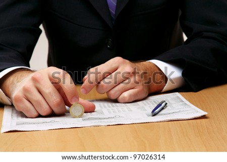 Businessman holding the coins