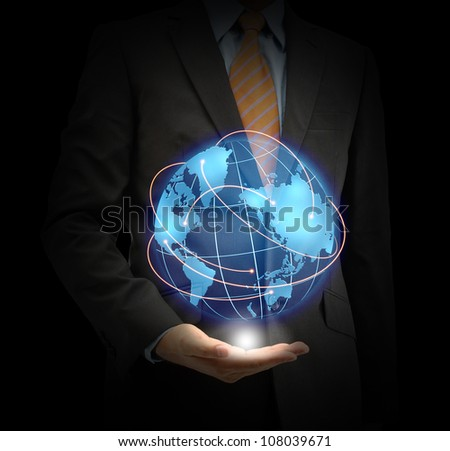Businessman holding the earth isolated on black