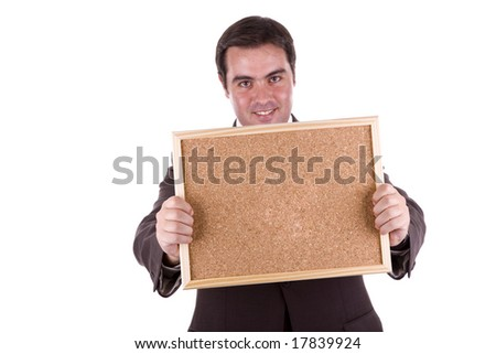 businessman holding the empty corkboard on white background - stock photo