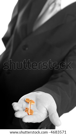 Businessman holding the gold key - stock photo