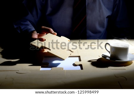 Businessman Holding The Last Piece - stock photo
