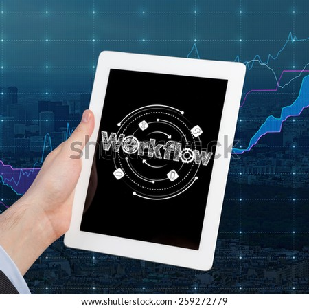 businessman holding touch pad with workflow - stock photo