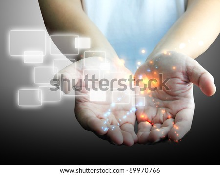 Businessman holding touchscreen - stock photo