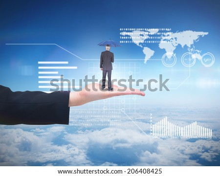Businessman holding umbrella against blue sky over clouds at high altitude