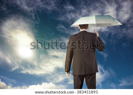 Businessman holding umbrella, business concept