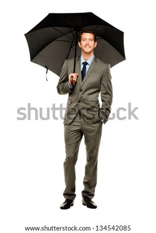 businessman holding umbrella smiling isolated white background - stock photo