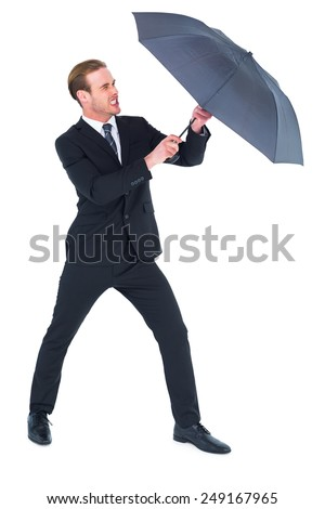 Businessman holding umbrella to protect himself on white background