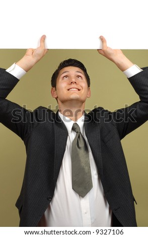 Businessman holding up a black sign expandable for copy - stock photo