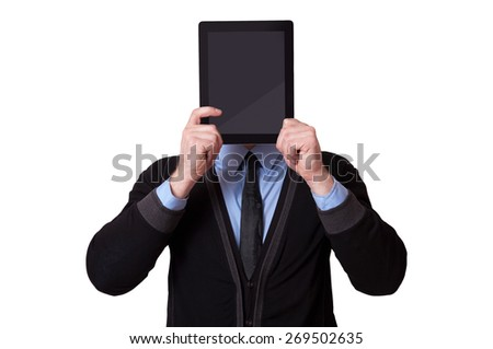 Businessman holding up a blank tablet pc in front of his face, isolated on white background - stock photo