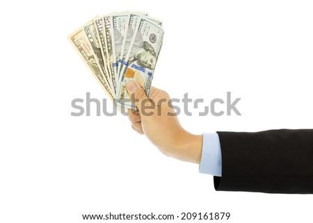 Businessman holding us dollar . isolated on a white background - stock photo