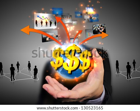 businessman holding US dollar sign - stock photo