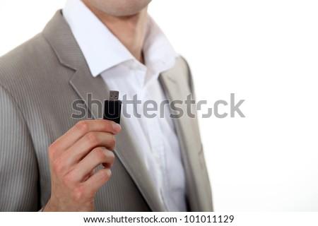 Businessman holding USB key - stock photo