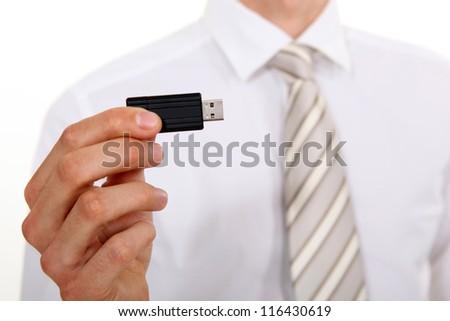 Businessman holding USB stick - stock photo