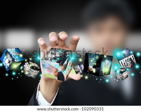 Businessman holding virtual box - stock photo